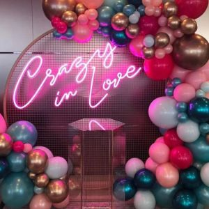 Crazy In Love Wedding Sign in brilliant LED neon flex shown in pink with balloons - photo from CustomNeon.com