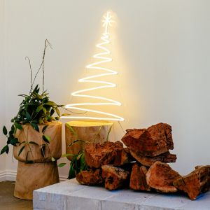Modern LED Neon Flex Christmas Tree Decoration shown near a heart with split logs - photo CustomNeon.com