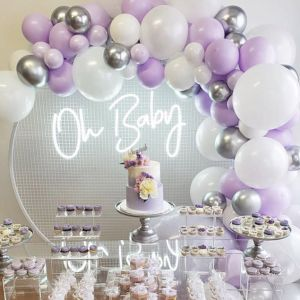 Oh Baby baby shower sign shown surrounded by balloons and cakes - photo from CustomNeon.com