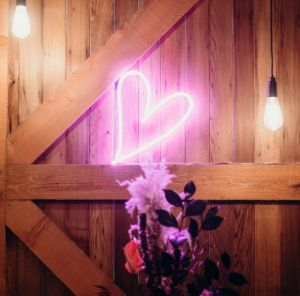 Small LED neon art for weddings and home decor shown leaning against the wall - photo from CustomNeon.com